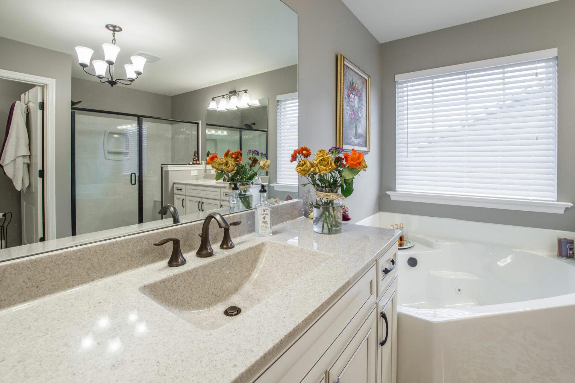 Bathroom with bathtub and visible shower area