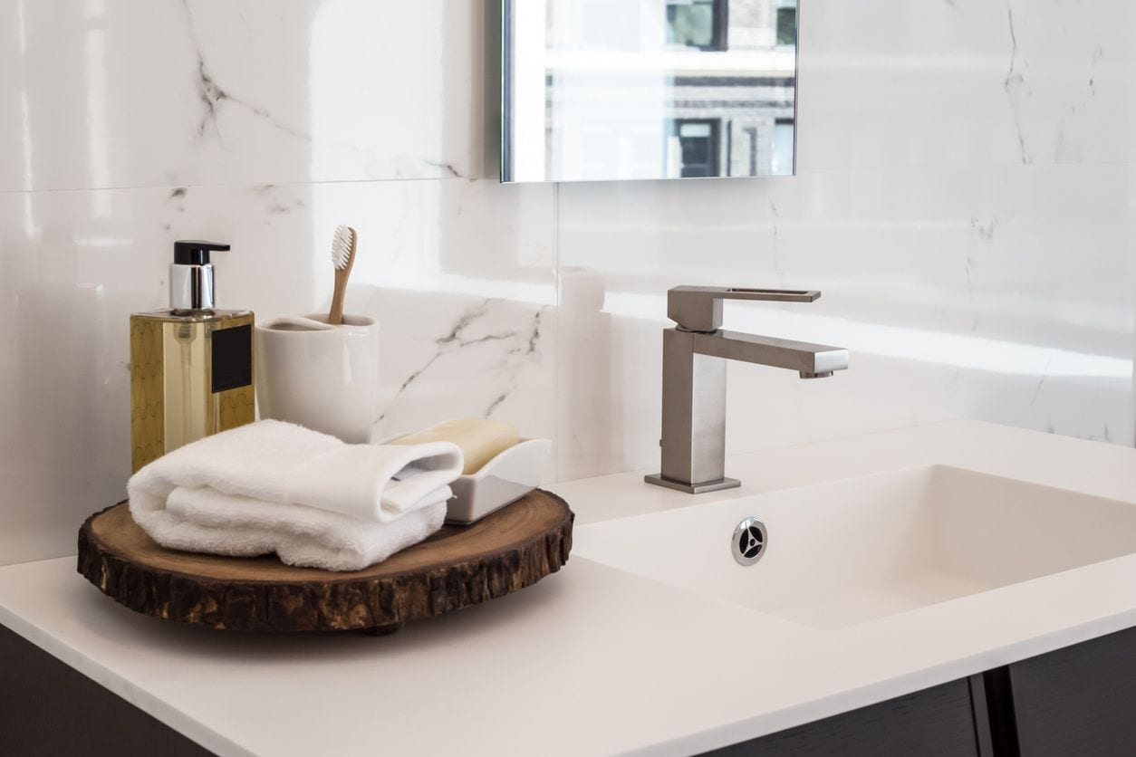 Sink with toiletries and hand soap dispenser